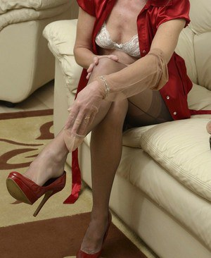 Hot blond mature lady fucked on the couch 2